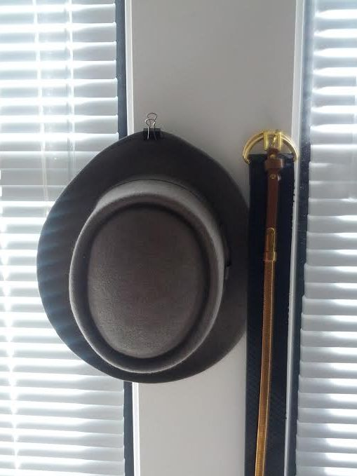 hat-and-belt-wall-decor