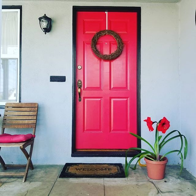 Get inspired from these amazing front doors and front door ideas to create your own inviting entryway! This red door is...